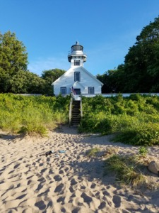 Photo of sandy beach in front of Old Mission Lighthouse